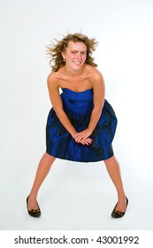 The attractive girl in a dark blue dress