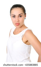 Attractive girl with dark hair wearing white t-shirt and shows tongue Half-lenght portrait on white background, isolated