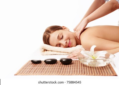 Attractive girl doing massage on white background