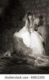 attractive girl in the hay. runaway bride