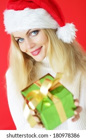 Attractive girl holding a gift
