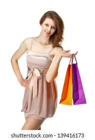 Attractive girl holding multicolored shopping paper bags - closeup shot isolated on white