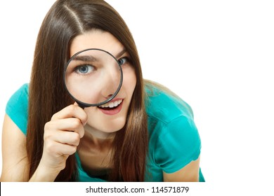 Attractive girl looking through a magnifying glass over white background