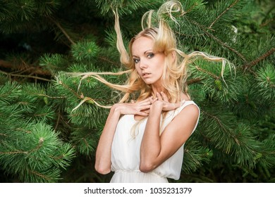Attractive girl made a new hairstyle in the woods.