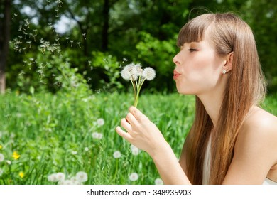 attractive girl on the field of dandelions