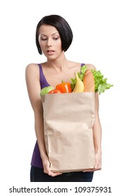 Attractive girl with the packet of vegetables, Isolated, white background. Healthy food