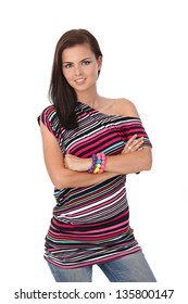 Attractive girl posing in multicolour top, smiling, looking at camera.