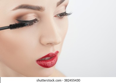 Attractive girl is putting on make-up