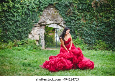 Attractive girl in a royal red dress