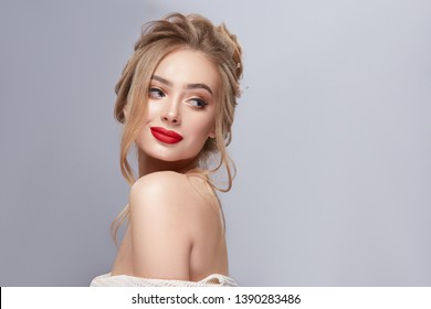 attractive girl with sexy make-up looking to the side and smiling