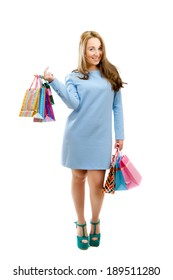 attractive girl with shopping bags isolated on white background