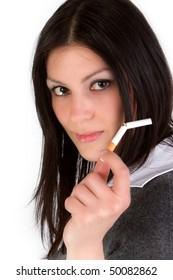 Attractive girl shows broken cigarette on white background