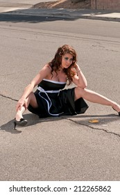 Attractive girl sitting on the road