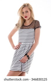 attractive girl in a striped dress
