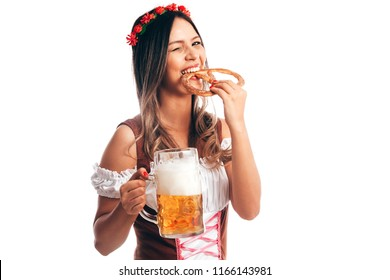 Attractive girl in traditional german costume with pretzel and beer on Oktoberfest, isolated on white