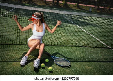 Attractive girl in uniform on the tennis court