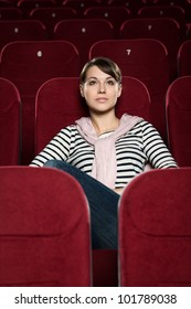 Attractive girl watching  movies alone