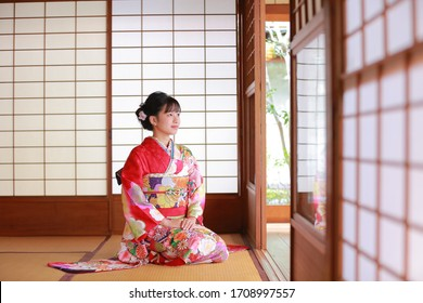 Attractive girl wearing traditional japanese kimono in kyoto, Japan.