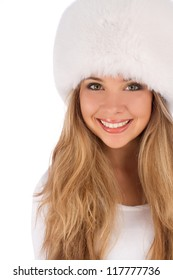 Attractive girl wearing white fur hat isolated on white