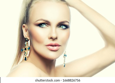 Attractive glamour girl beauty face, perfct skin, eye shadow make-up, luxury jewelry earrings