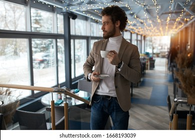 attractive guy enjoying hot coffee at the cafe, enjoyment, interets, hobby, coffee break, man having a rest indoors.