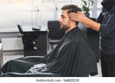 Attractive guy getting service in beauty salon