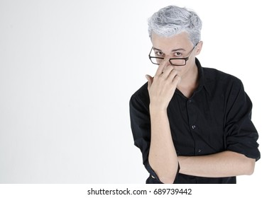 An attractive guy with gray hair. Gray background.