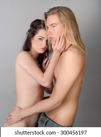 Attractive, Half Naked Couple Embracing