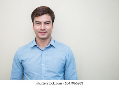 Attractive handsome smiling positive caucasian happy business man. Closeup portrait caucasian polite middle age man wearing blue shirt