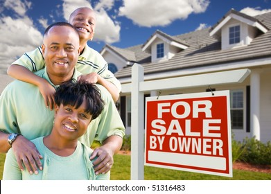 Attractive, Happy African American Family with For Sale By Owner Sign in Front of House.