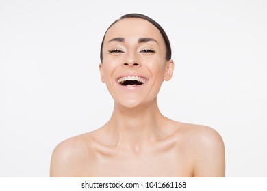Attractive happy beautiful young woman with clean and fresh skin and healthy hair. Spa treatments. Cosmetology. Skin care. Strong hair and healthy body