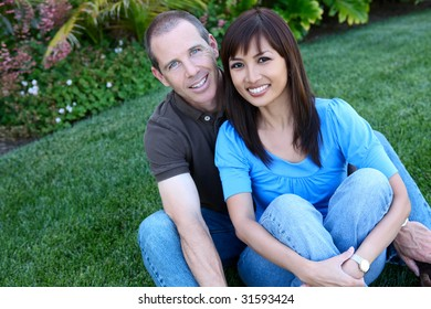 An attractive happy diverse couple in the park
