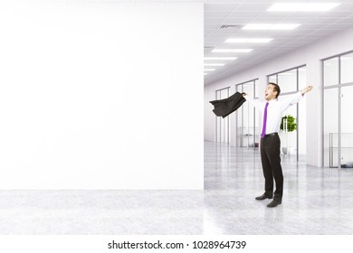 Attractive happy european businessman celebrating success in modern office interior with copy space on wall. Mock up, 3D Rendering