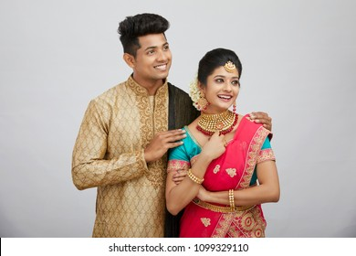 Attractive happy north Indian couple in traditional dress