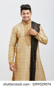 Attractive happy north Indian young groom in traditional dress