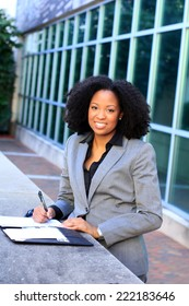 Attractive Happy and Smiling African American Business Professional Business Woman Wearing Suit