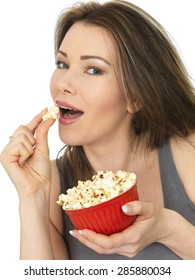 Attractive Happy Young Caucasian Woman Eating and Enjoying a Bowl of Popcorn Wearing A Grey Vest Top Shot Against White