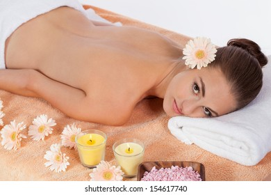 attractive healthy caucasian woman hot stone massage wellness  spa therapy