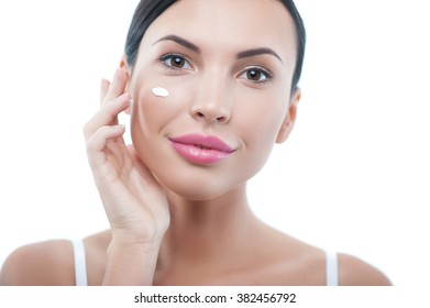 Attractive healthy girl is making her skin perfect