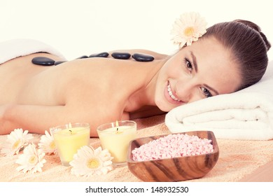 attractive helathy caucasian woman hot stone massage wellness  spa therapy