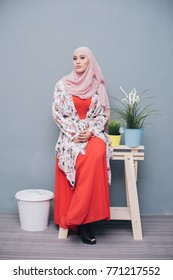 Attractive hijab fashionable women with face expression. Muslimah fashion portraiture. 20s age.