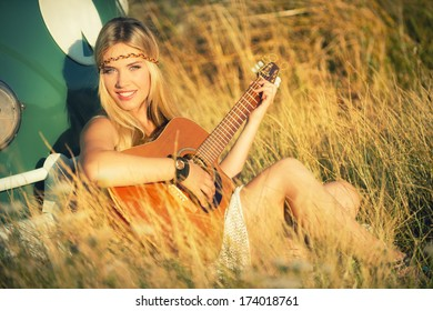 attractive hippie girl with guitar