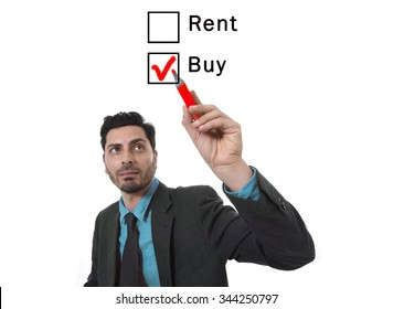 Attractive Hispanic businessman choosing rent or buy option at formular ticking buying box with red marker on glass isolated on white background in housing real estate and property owner concept