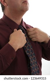 Attractive hispanic businessman dressing up for office