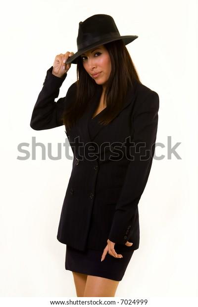 Attractive Hispanic dark hair woman wearing black attire and black gangster style hat