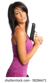 attractive hispanic woman holding a gun on a white background