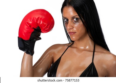 Attractive hispanic woman portrait with boxing gloves.