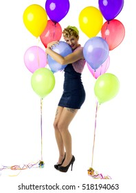 Attractive housewife posing at birthday party with balloons and having fun.  Image isolated on white background