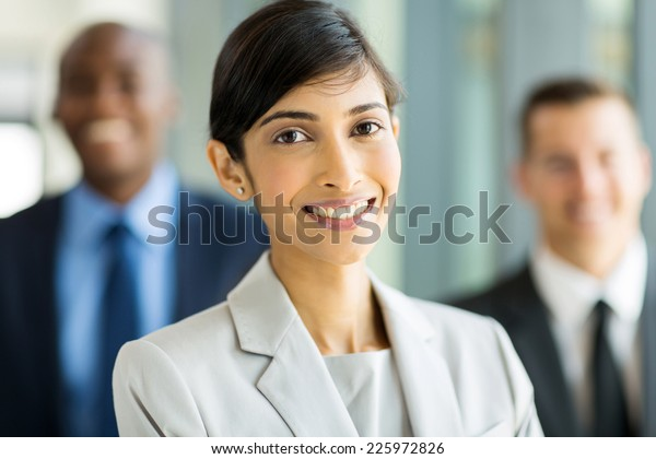 attractive indian business executive with business team