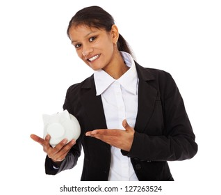 Attractive indian businesswoman holding piggy bank. All on white background.